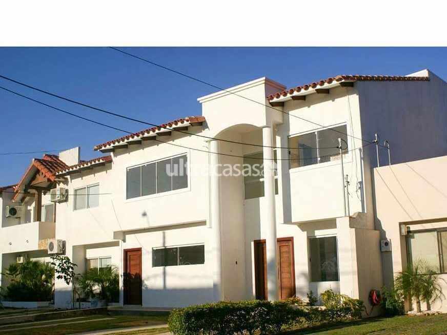 Casa en Venta Av. Banzer km 9 sobre av. condominio Barcelo seguridad 24 horas, club house, piscinas, churrasqueras, parques infantiles y canchas deportivas. Foto 1